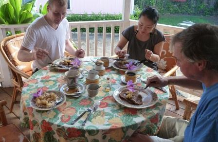 Guests eating breakfast on the back lanai of Kauai Beach Inn, Poipu Bed and Breakfast