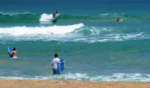 Surfers & Bodyboarders at Hanalei Beach